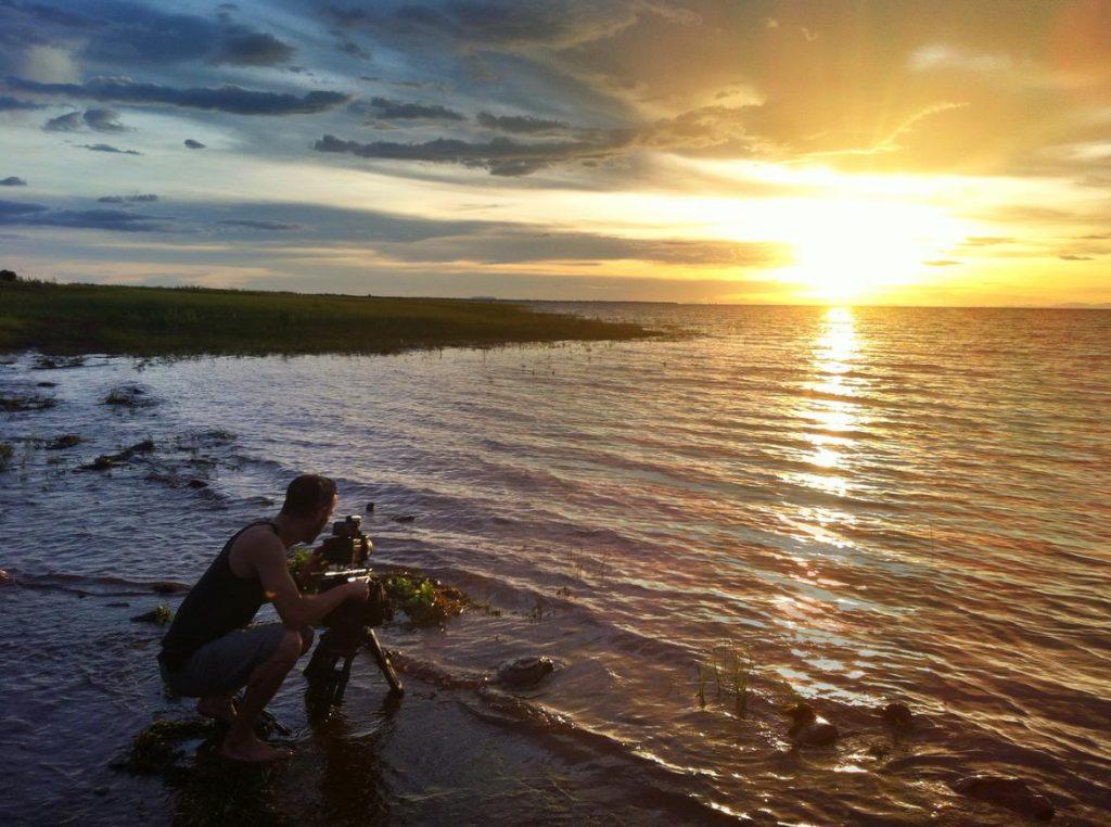 LAKE KARIBA MATUSADONA NATIONAL PARK ZIMBABWE AFRICA: Matthew Hood filming the sunset. (Photo Credit: MATTHEW HOOD/ DON PERCIVAL/ Goddunnit Promotions)